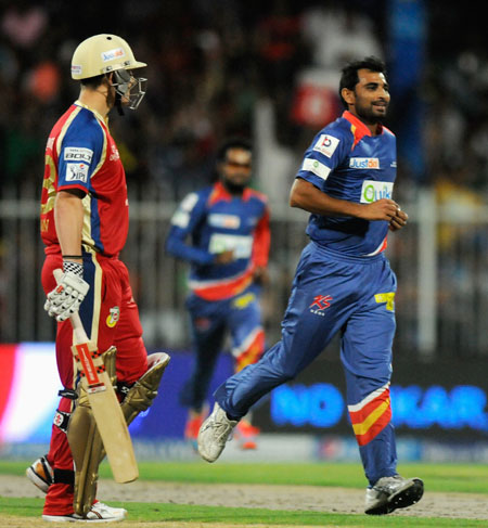 Mohammed Shami exults after a wicket