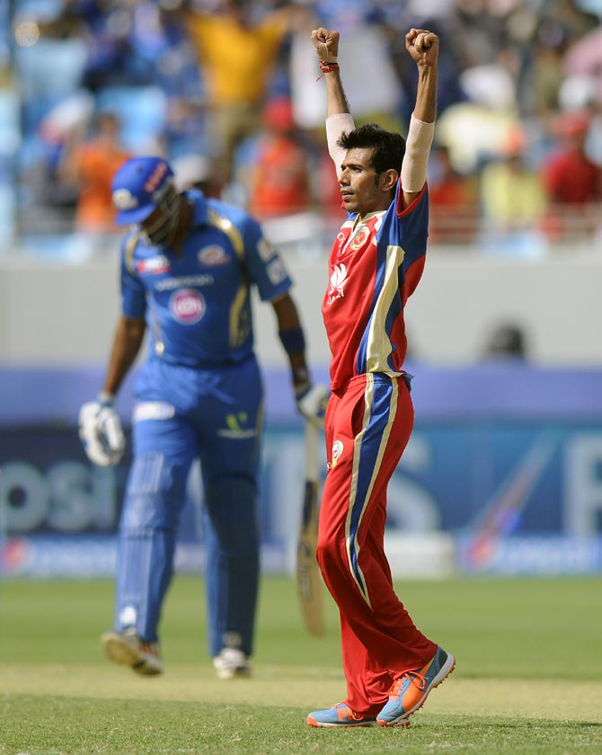 Yuzvendra Chahal celebrates the wicket of Kieron Pollard