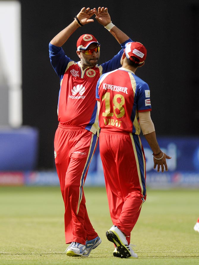 Yuvraj Singh and Virat Kohli (right) celebrate the run out of Lasith Malinga