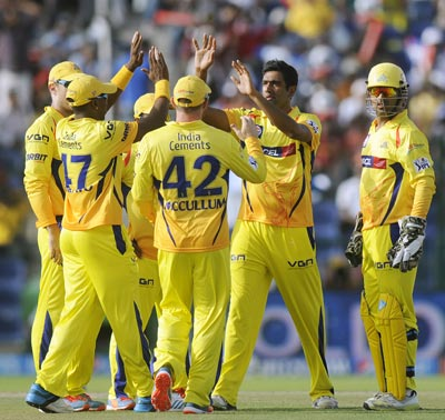 Chennai players celebrate the fall of a wicket