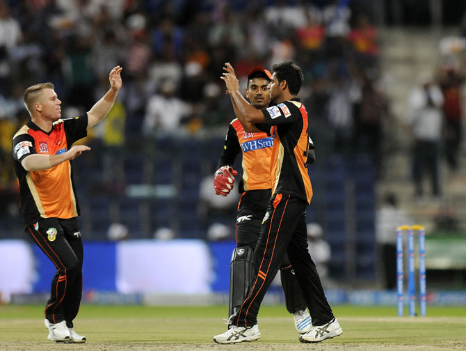 Bhuvneshwar Kumar celebrates with David Warner after taking a wicket
