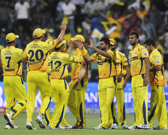 Chennai Super Kings players celebrate the fall of a Delhi wicket