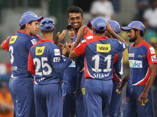 Jaydev Unadkat celebrates a wicket with his Delhi teammates
