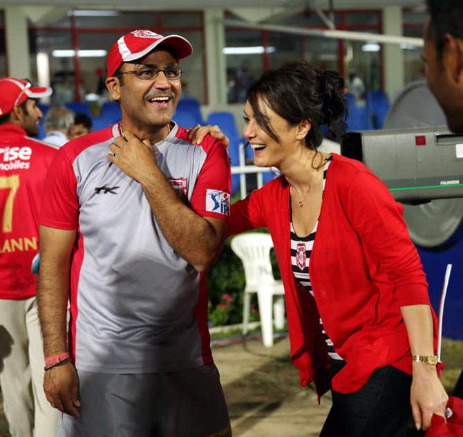 Preity Zinta (right) speaks to Virender Sehwag