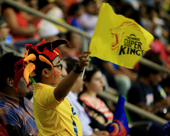A young fan waves a Chennai Super Kings' team flag on Monday