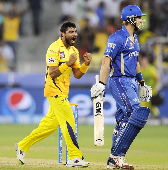 Ravindra Jadeja celebrates as Shane Watson (right) walks back after his dismissal