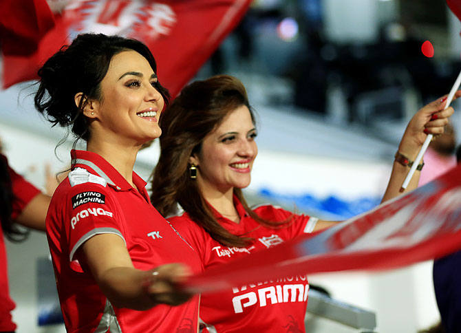 Preity Zinta and a friend are all smiles as Punjab go about their business in the middle