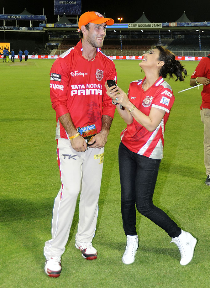 Glenn Maxwell and Preity Zinta share a laugh after the match on Tuesday