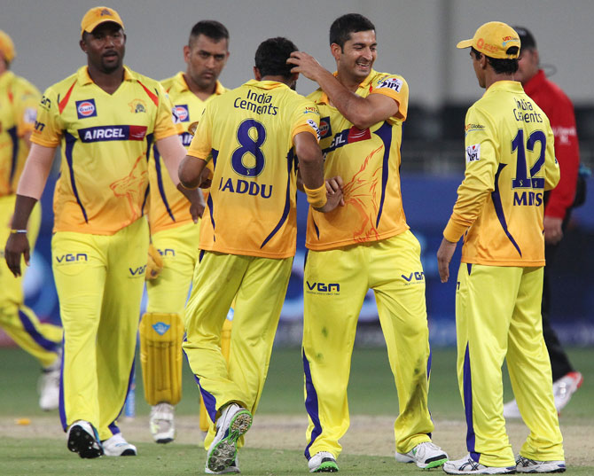 Mohit Sharma celebrates a win with his Chennai Super Kings teammates