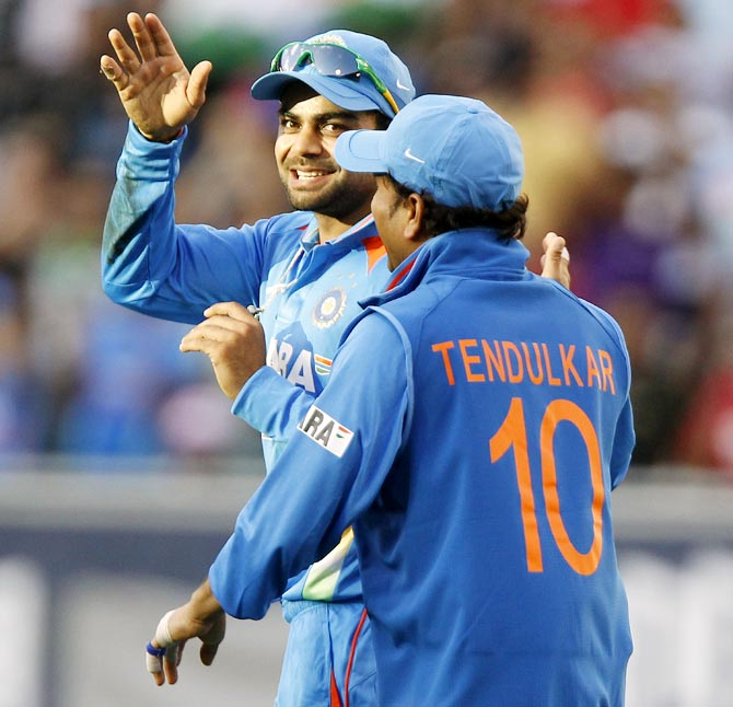 Sachin Tendulkar (right) with Virat Kohli