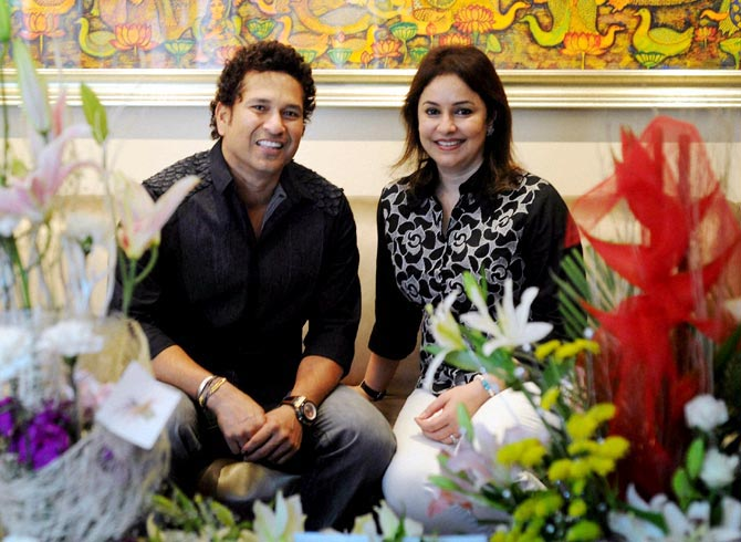 Sachin Tendulkar poses for a photograph with his wife Anjali during his 41st bithday celebrations at his residence in Mumbai on Thursday.