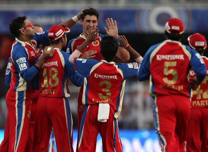 Mitchell Starc is congratulated by his Royal Challenger Bangalore teammates after dismissing Gautam Gambhir