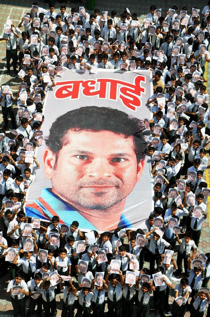 School children greet Sachin Tendulkar on the eve of his birthday in Moradabad, on Wednesday.