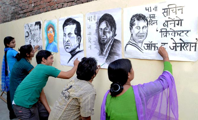 Artists make paintings of Sachin Tendulkar to wish him on the eve of his birthday in Moradabad, on Wednesday.