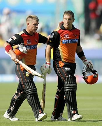 Hyderabad Sunrisers' David Warner and Aaron Finch walk back after their fine partnership against Delhi Daredevils on Friday.
