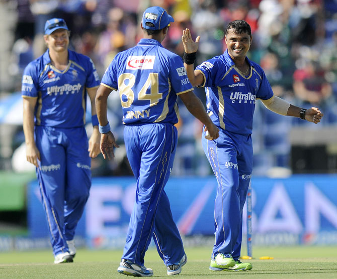 Pravin Tambe celebrates taking a wicket