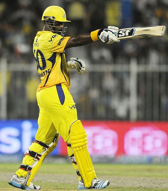Dwayne Smith celebrates after reaching his half-century