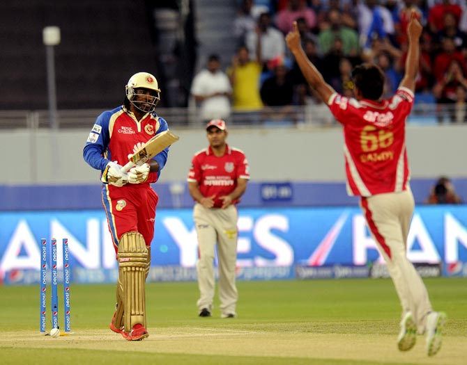 Sandeep Sharma celebrates the dismissal of Chris Gayle