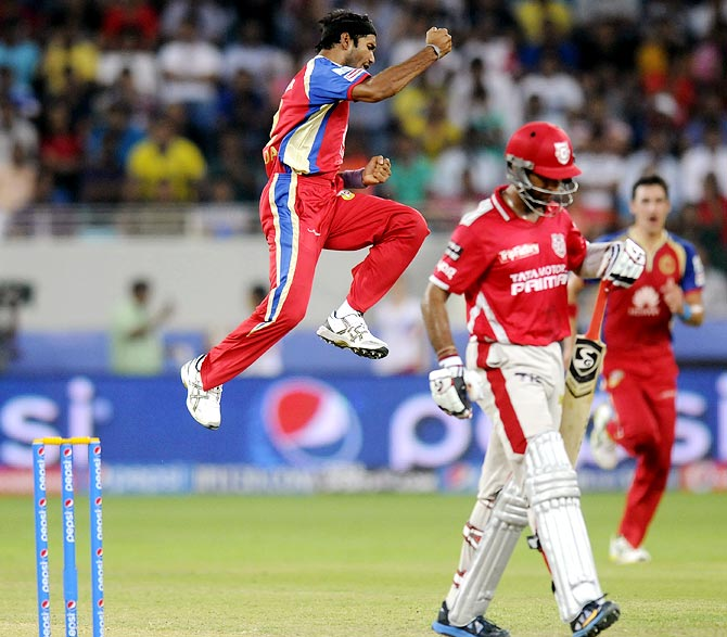 Ashok Dinda celebrates the wicket of Cheteshwar Pujara