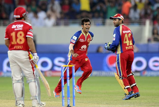 Yuzvendra Chahal (centre) celebrates after taking the wicket of Virender Sehwag