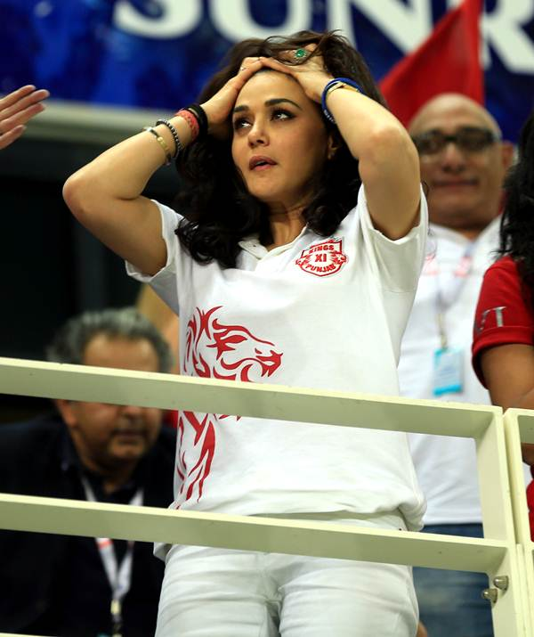 Priety Zinta is left stunned after Virender Sehwag is adjudged caught behind