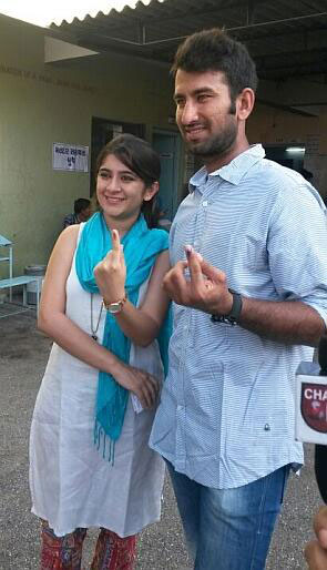 Cheteshwar Pujara and his wife after casting their vote