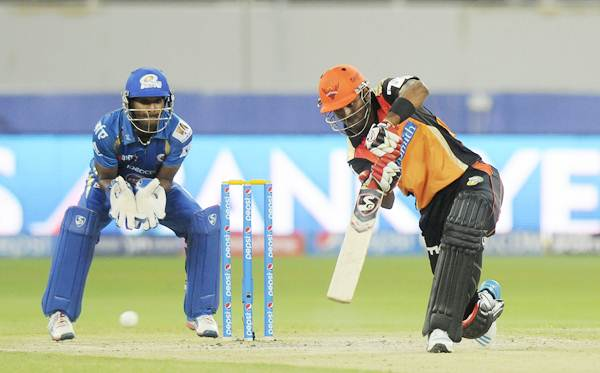 Mumbai Indians wicketkeeper Chidhambaram Gautam watches as Lokesh Rahul steps out to drive