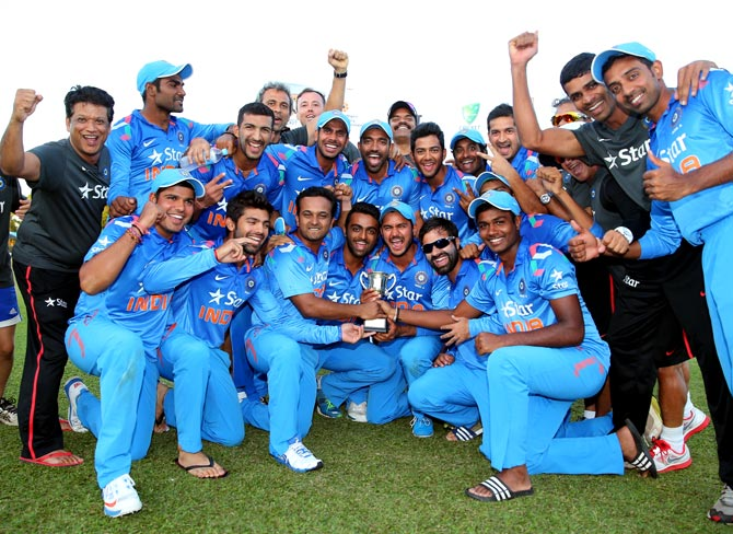 India 'A' players celebrate with the trophy after winning the Quadrangular A-Team One-Day Series in Darwin, on Saturday.