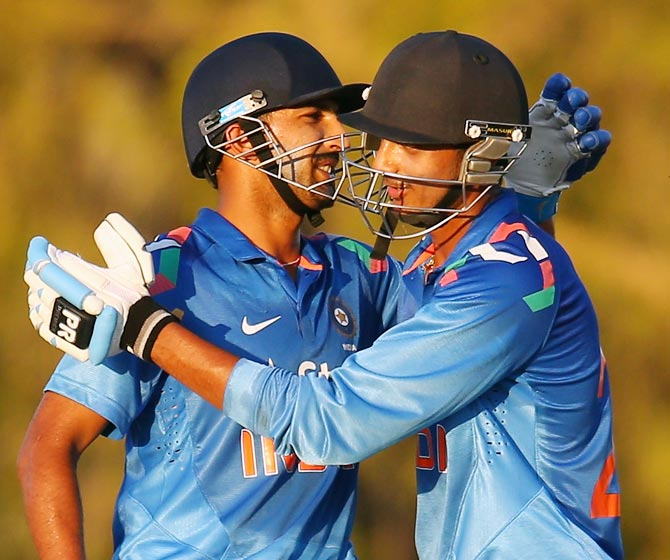 Rishi Dhawan (left) celebrates with Akshar Patel