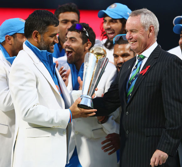 India captain MS Dhoni receives the winners trophy