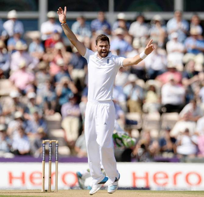 England's James Anderson (right) celebrates after taking a wicket