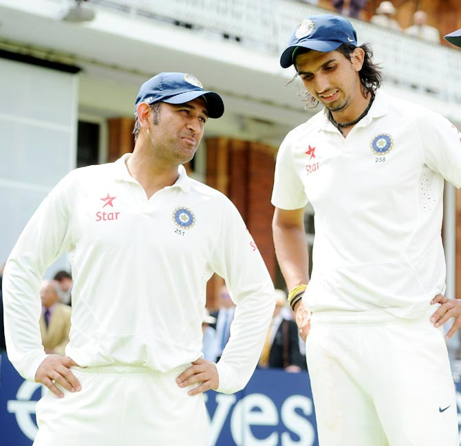Mahendra Singh Dhoni (left) speaks with Ishant Sharma
