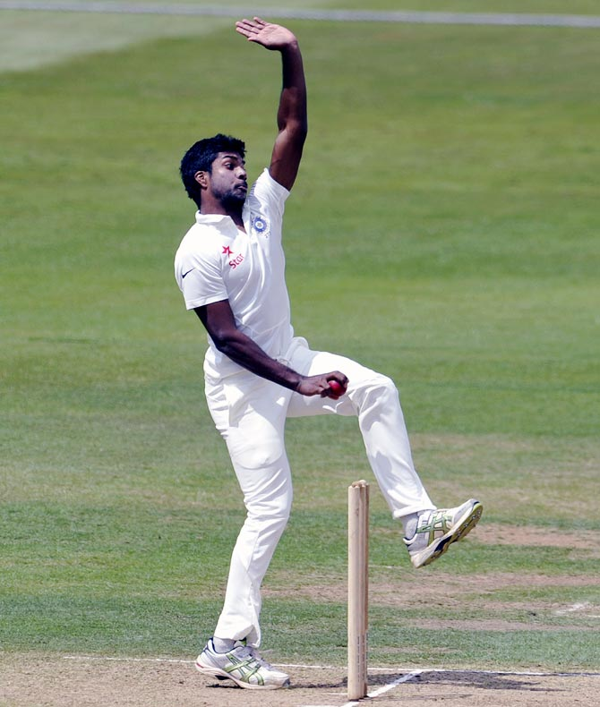 Varun Aaron of India bowls