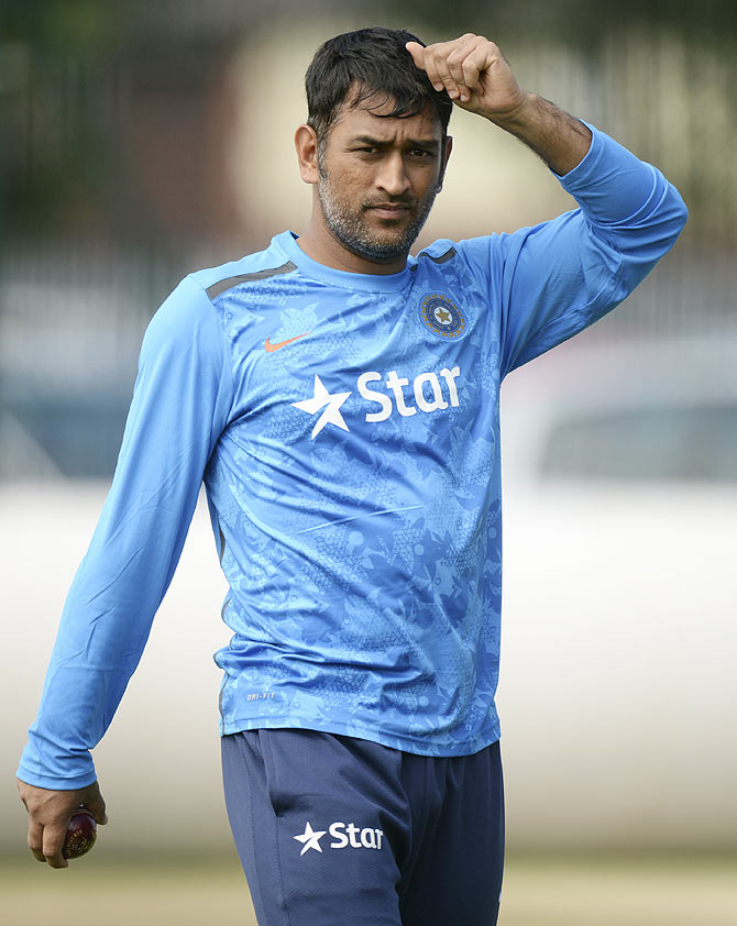 India's Mahendra Singh Dhoni looks on during a training session before the fourth cricket Test match against England at the Old Trafford cricket ground, Manchester on Tuesday