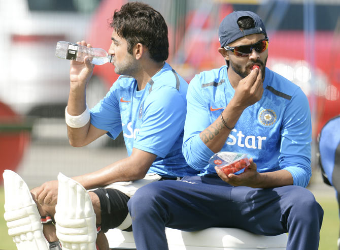 India's Ravindra Jadeja (right) eats a strawberry as he sits with team-mate Gautam Gambhir during a training session at the Old Trafford cricket ground, Manchester on Tuesday