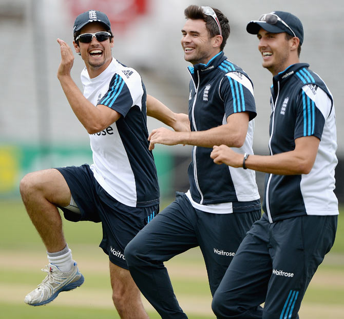 England captain Alastair Cook shares a joke with James Anderson and Steven Finn during a nets session at Old Trafford on Tuesday