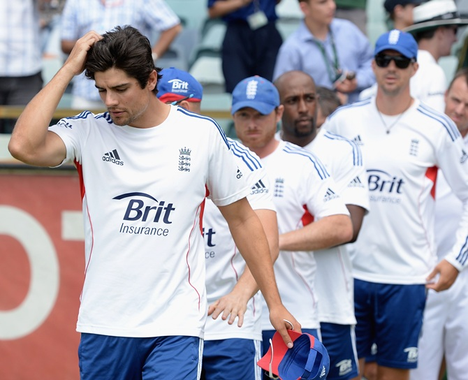 England captain Alastair Cook with teammates