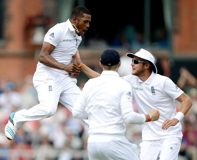 Chris Jordan (left) of England celebrates dismissing Ajinkya Rahane of India