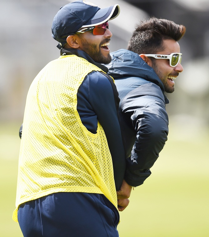 India batsman Ravindra Jadeja, left, and Virat Kholi share a lighter moment