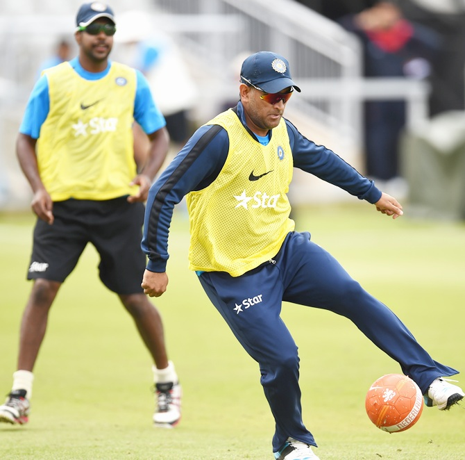 India captain Mahendra Dhoni, right, in action during a game of football