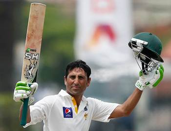 Pakistan's Younis Khan celebrates after completing 150 runs on the second day of the first Test against Sri Lanka in Galle