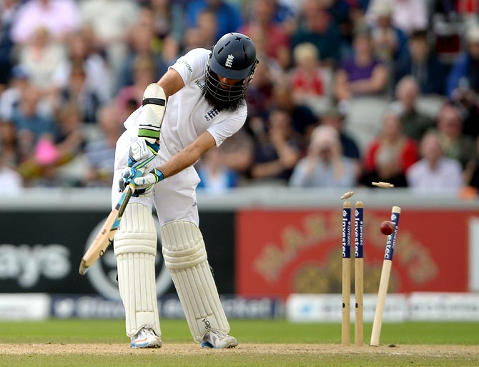 Moeen Ali of England is bowled by Varun Aaron