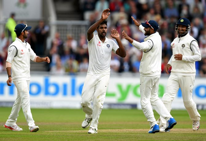 India bowler Varun Aaron (centre) celebrates after dismissing England batsman Moeen Ali