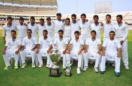 Karnataka's players pose after winning the Ranji Trophy last season