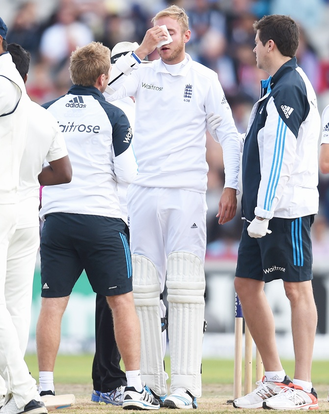 England batsman Stuart Broad receives treatment after being hit by a ball