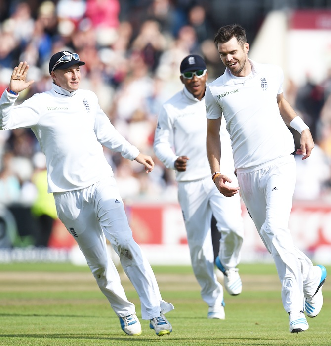 James Anderson (right) goes on a celebration run with Joe Root (left) and Chris Jordan (centre) after India batsman Virat Kohli is dismissed