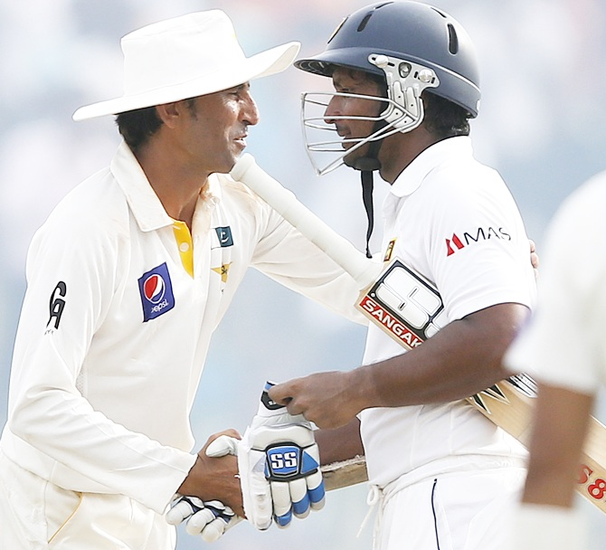 Sri Lanka's Kumar Sangakkara, right, is congratulated by Pakistan's Younis Khan