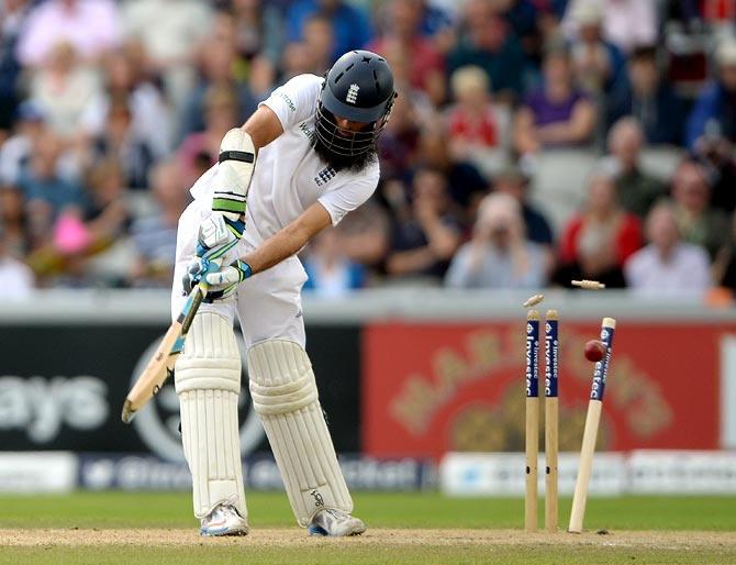 Moeen Ali of England is bowled by Varun Aaron