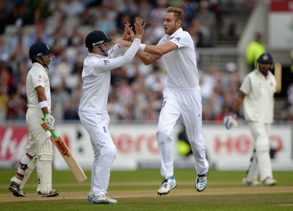 Stuart Broad of England celebrates with Sam Robson after dismissing Gautam Gambhir of India
