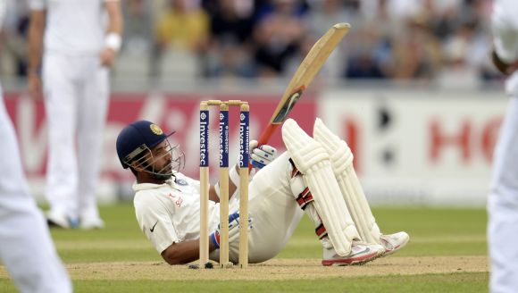 Ajinkya Rahane falls on the ground